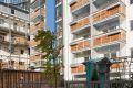 Sean Harrington Architects-York street housing court yard timber steel beams urban seating plants balcony concrete artwork play area