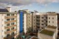 Sean Harrington Architects-York street housing court yard timber steel beams urban seating plants balcony concrete artwork flat roof sod